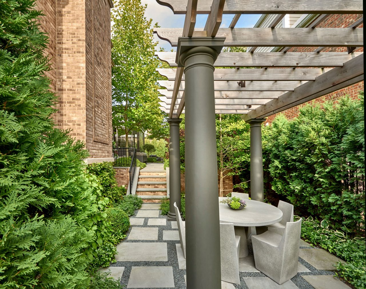 Small intimate garden with a traditional pergola and random dimensioned bluestone steppers with gravel joints.