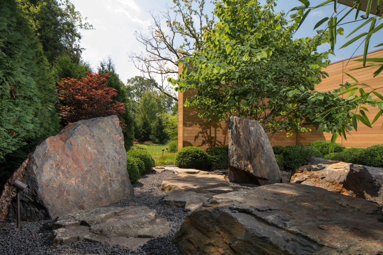 Irregular boulder creating path into backyard