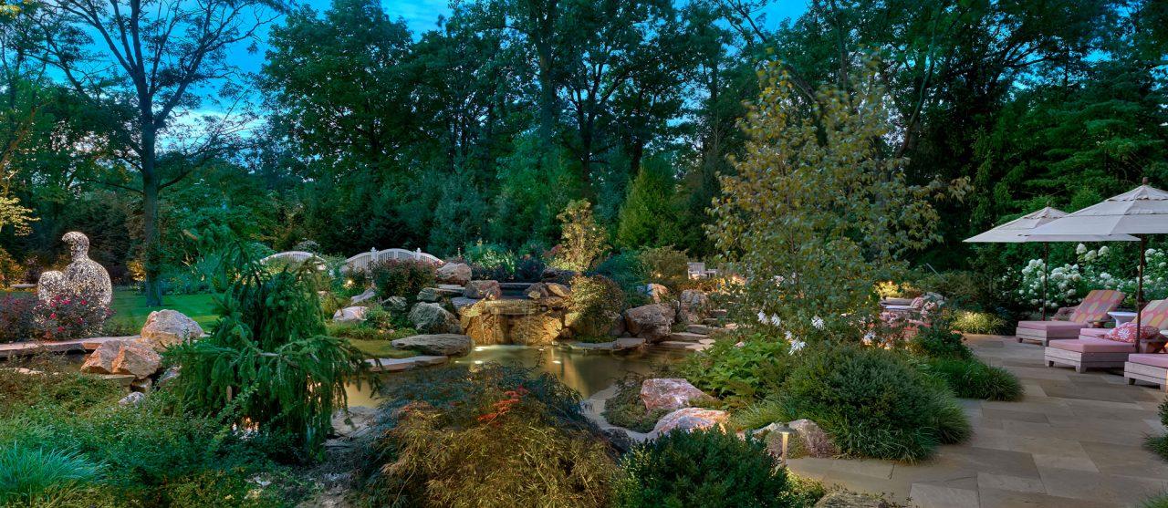 Landscape architecture promoting sculpture focus and pond