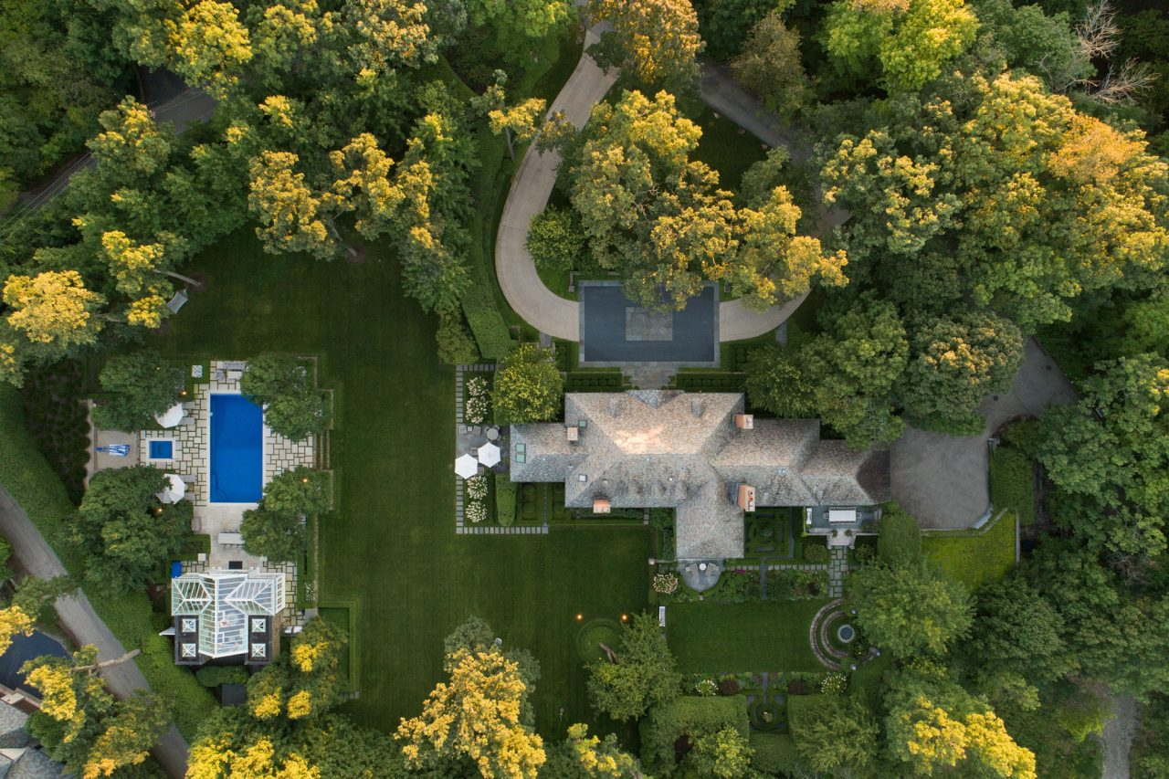 An award winning formal, residential landscape design with a pool and destination gardens.