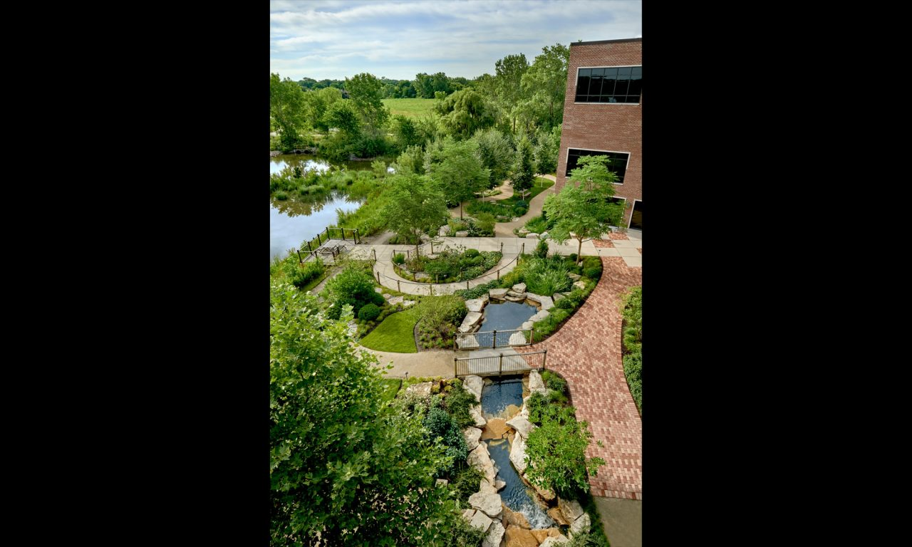 An award winning commercial landscape design featuring a natural creek, boulder outcropping and multiple garden destinations.
