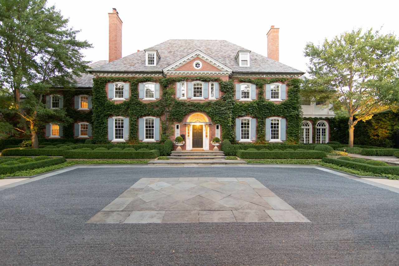 Formal residential entrance with symmetrical linear boxwood hedges, bluestone curbs, steps and paving.