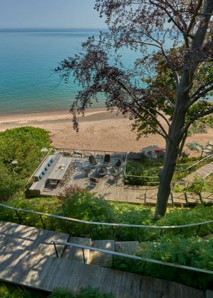 Cliff overlooking Lake Michigan with wooden path leading to the beach.