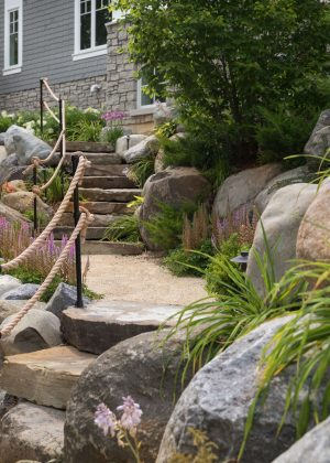 Bluff path with granite boulder steps and rope railing