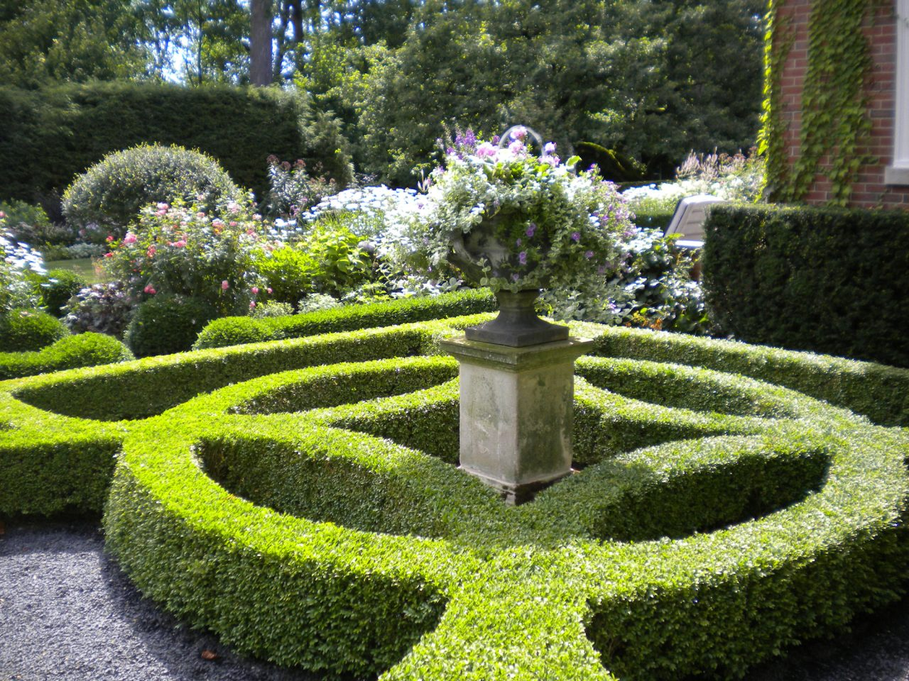 Boxwood Parterre in Perennial Garden with lead urn atop a limestone pedestal