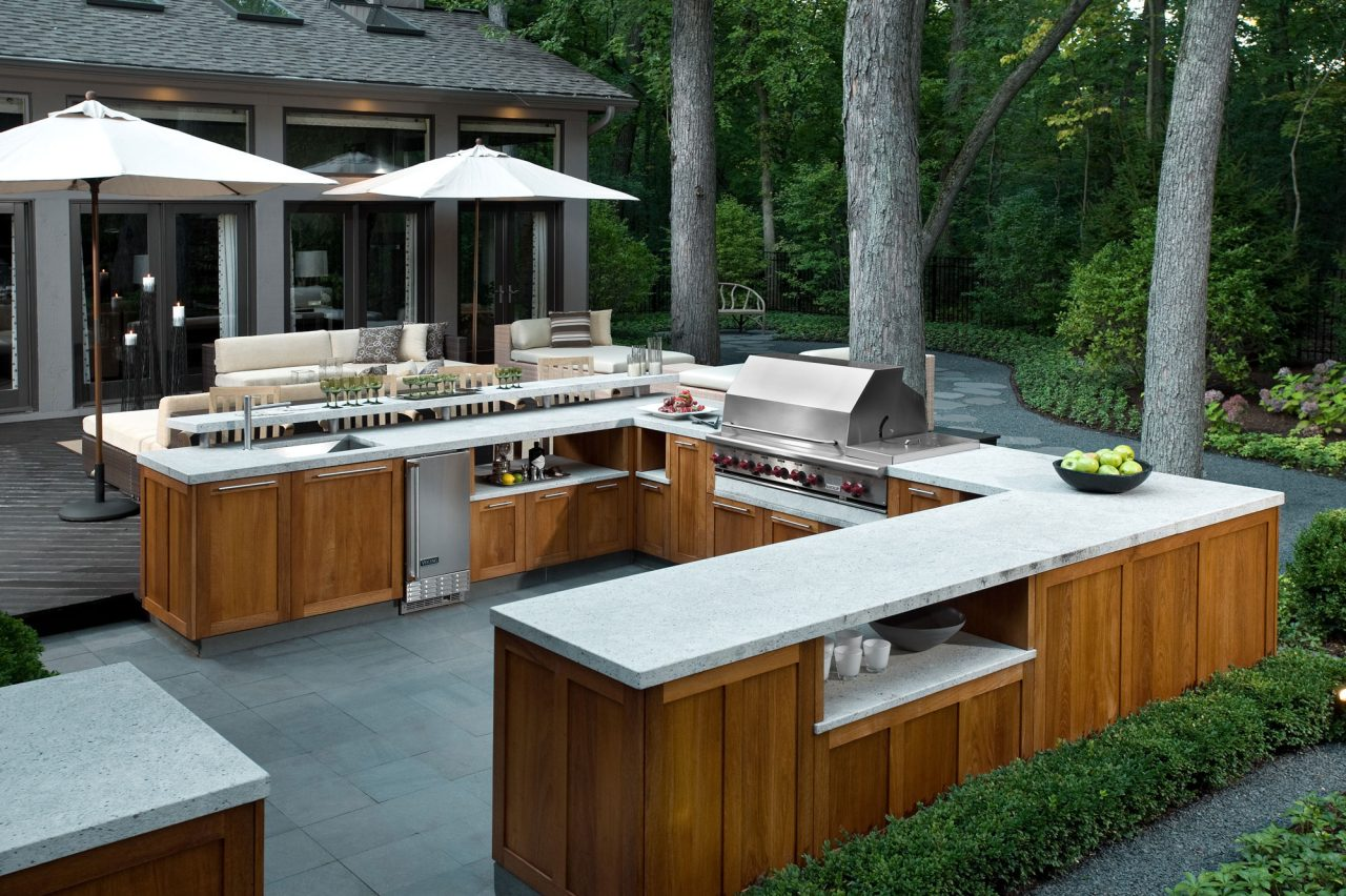 Contemporary outdoor kitchen custom cabinetry with bluestone paving