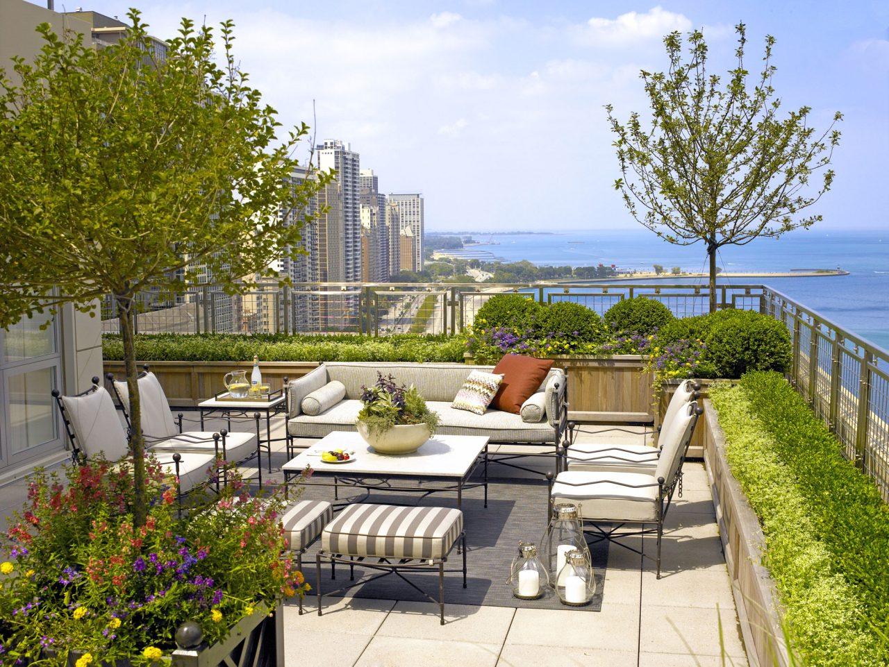 Lake Shore Drive, Chicago rooftop garden with boxed trees, boxwood hedges, and seasonal flowers