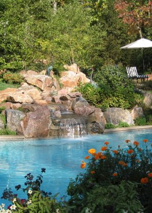 Natural set boulders create spectacular waterfall into pool
