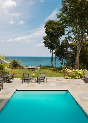 Waterfront view over Lake Michigan. Pool and spa surrounded by full range bluestone