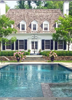 Hedge garden surrounding rectangular pool and spa. Landscape architect to blend beautiful with structure of home.