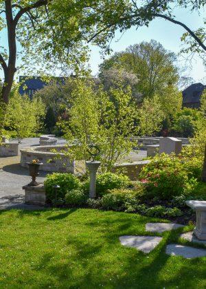 Circular masonry walls artistically form an area for gathering