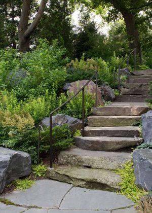 Boulder steps through bluff surrounded by natural landscape