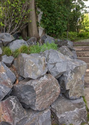 Fieldstone slab steps with boulder wall and boulder outcroppings