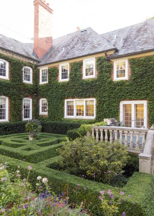 Formal garden contrasts with wild flowers