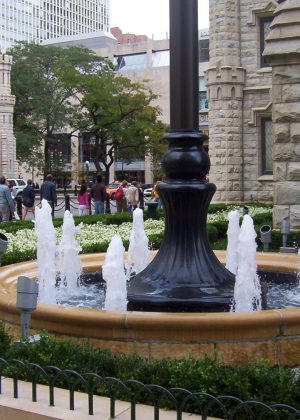 Chicago Water Tower fountain amongst urban background