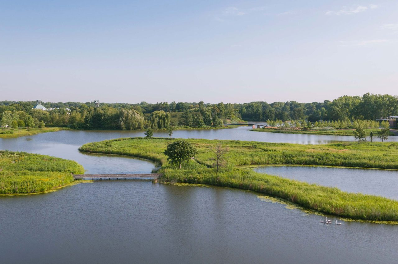 Aerial shot of Dixon Prairie at Chicago Botanic Garden featuring ponds with swans and bridges