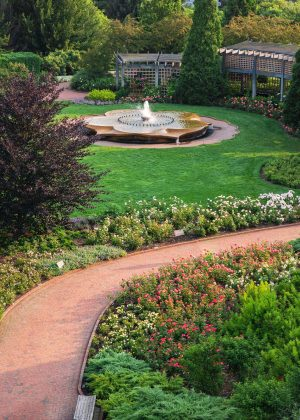 Aerial shot of fountain, brick path, pergola, and rose flower beds in Rose Garden at Chicago Botanic Garden
